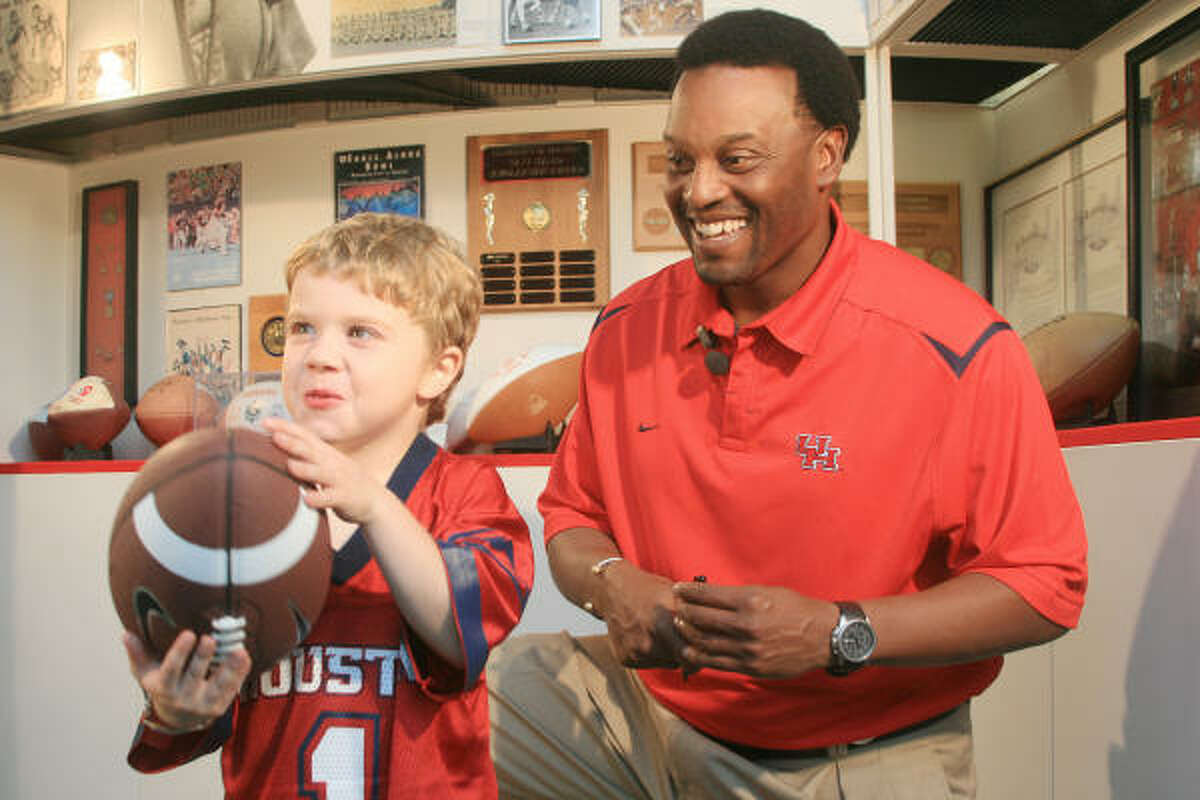 Joel Poysky, 6, of Fort Bend County, and University of Houston football head coach Kevin Sumlin shoot a public service announcement to raise awareness for Duchenne.