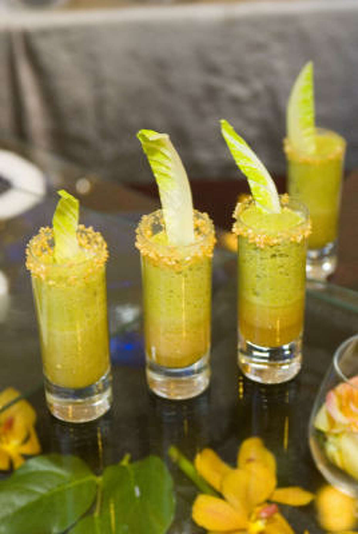 Parmesan broth and cilantro foam are part of an Asian Caesar shooter.