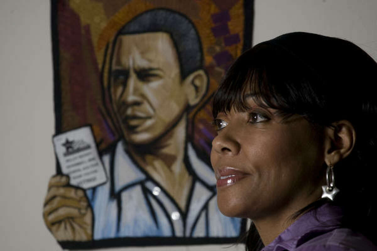 Carolyn Crump poses for a portrait with one of her Barak Obama quilt pieces.