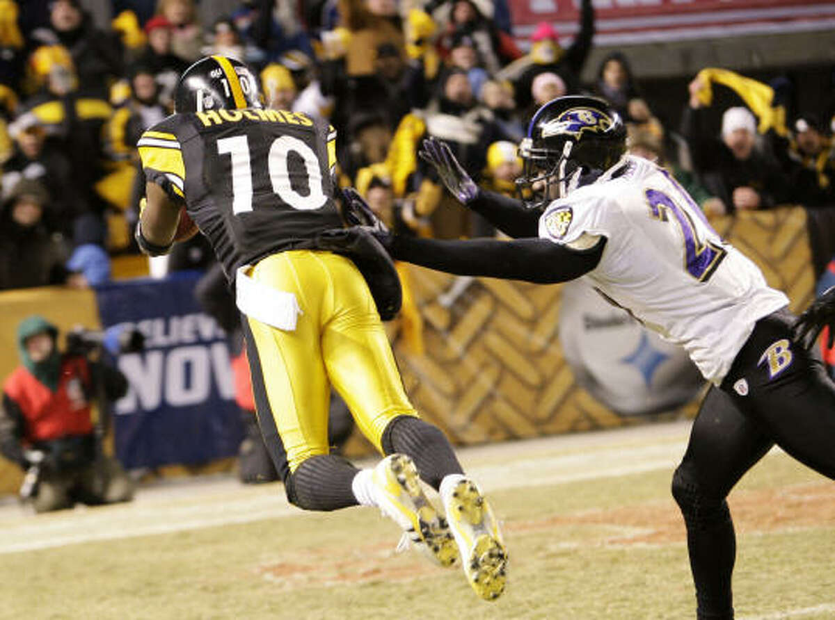 Steelers receiver Santonio Holmes dives past Ravens safety Ed Reed for a 65-yard touchdown catch in the second quarter.
