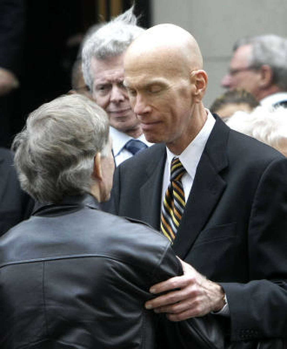 Paul Harvey Jr., right, son of legendary radio broadcaster Paul Harvey, talks with an unidentified man after a funeral service for his father at the Fourth Presbyterian Church in Chicago, Saturday.
