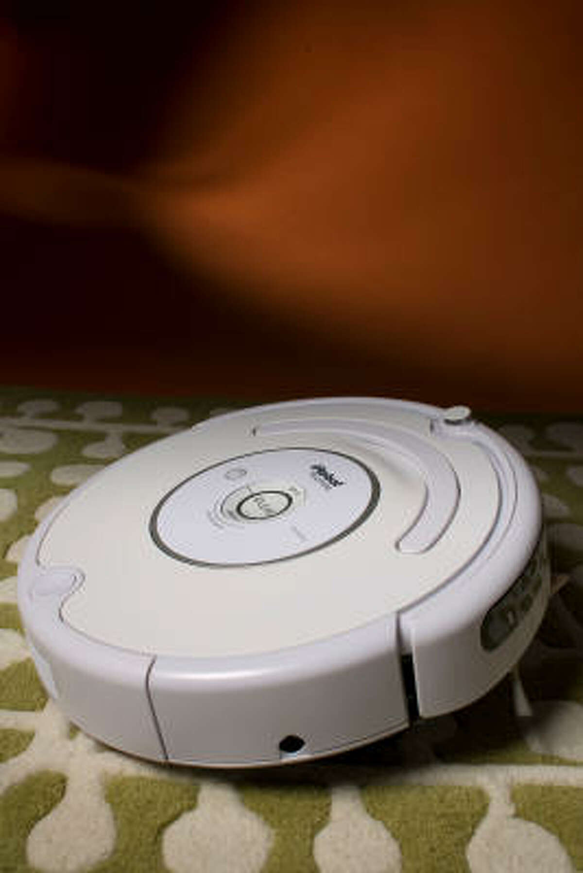 iRobot's Roomba vacuum cleaner can clean floors all by itself.