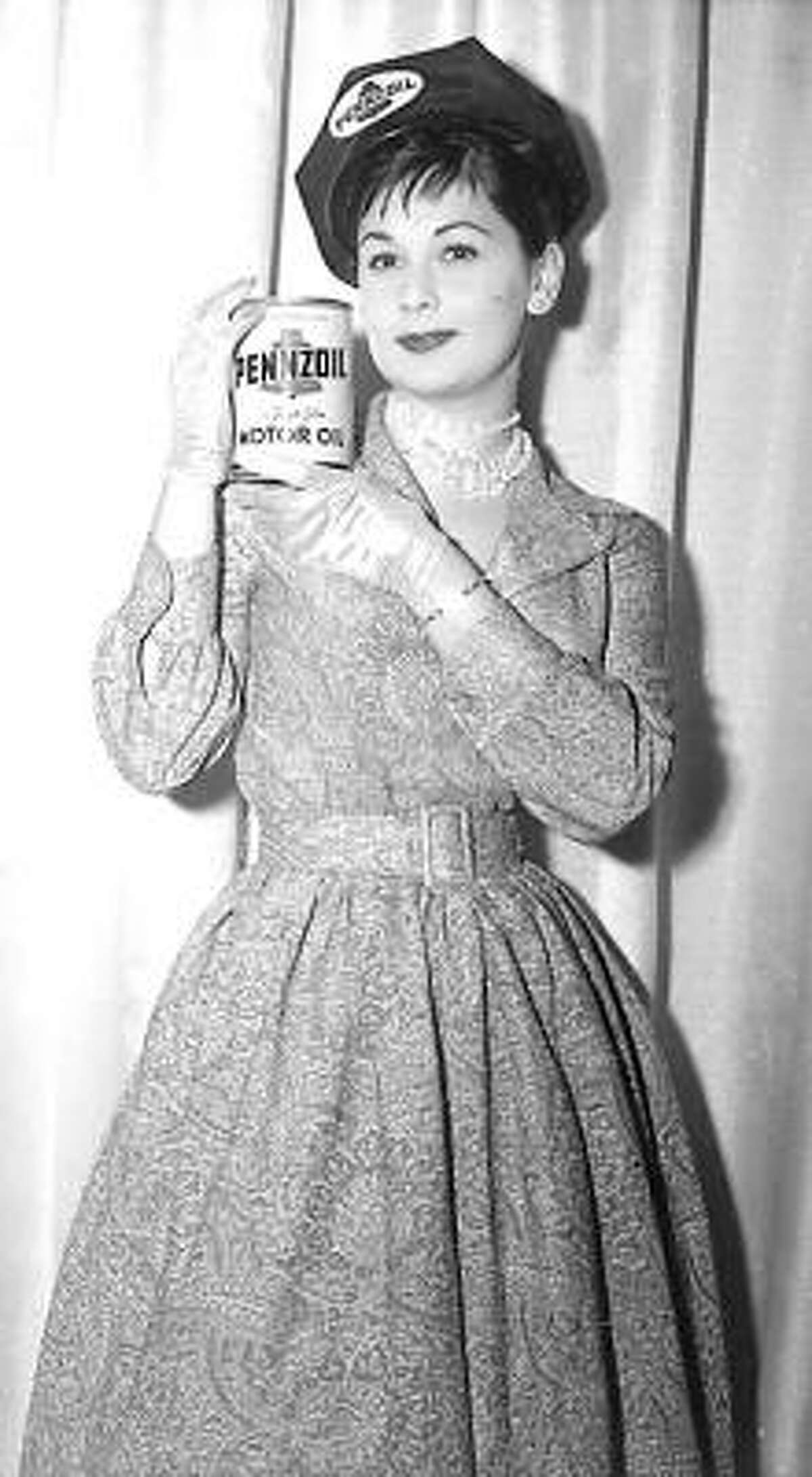 A Penny Pennzoil shows off the company's products in the early 1960s.