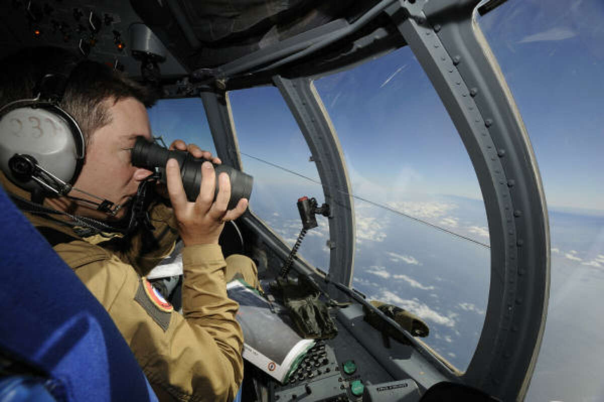 French army air crewman aboard an Atlantic Model 2 aircraft patrol the presumed site of the crash of a missing Air France flight.