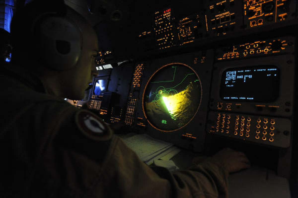 A French army air crewman aboard an Atlantic Model 2 aircraft monitors the crash site.