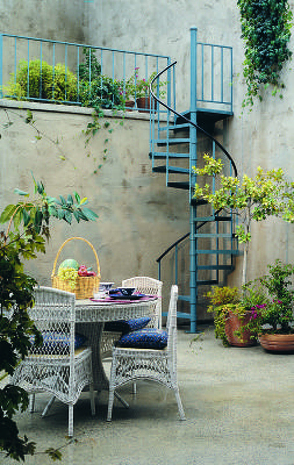 AHEAD OF THE CURVE: A spiral staircase like this one from the Iron Shop can open your garden up to another level.