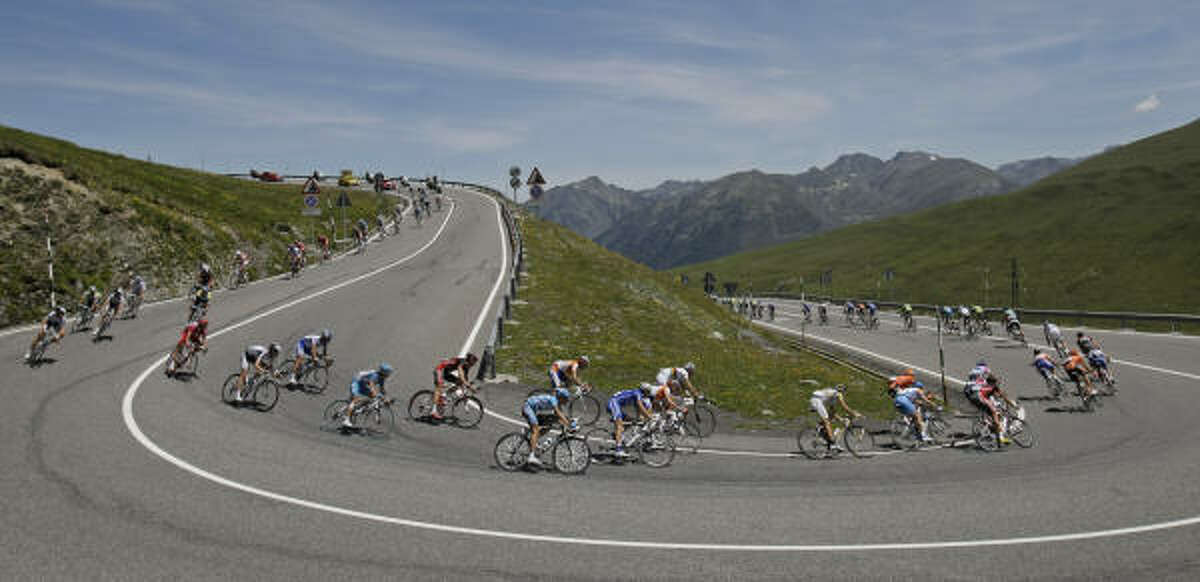 The pack negotiates a curve in the descent of Envalira Pass in the Pyrenees mountains.