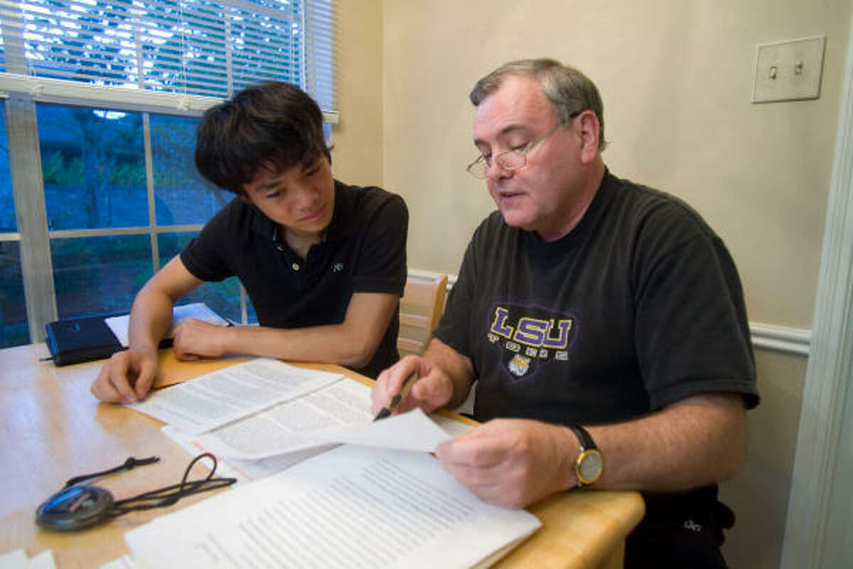 Stafford High School junior Phillip Yang, 17, and his debate coach Stan Magee work on Yang's debate presentation and arguments before a trip to the National Forensic League's Lincoln-Douglas debate tournament.