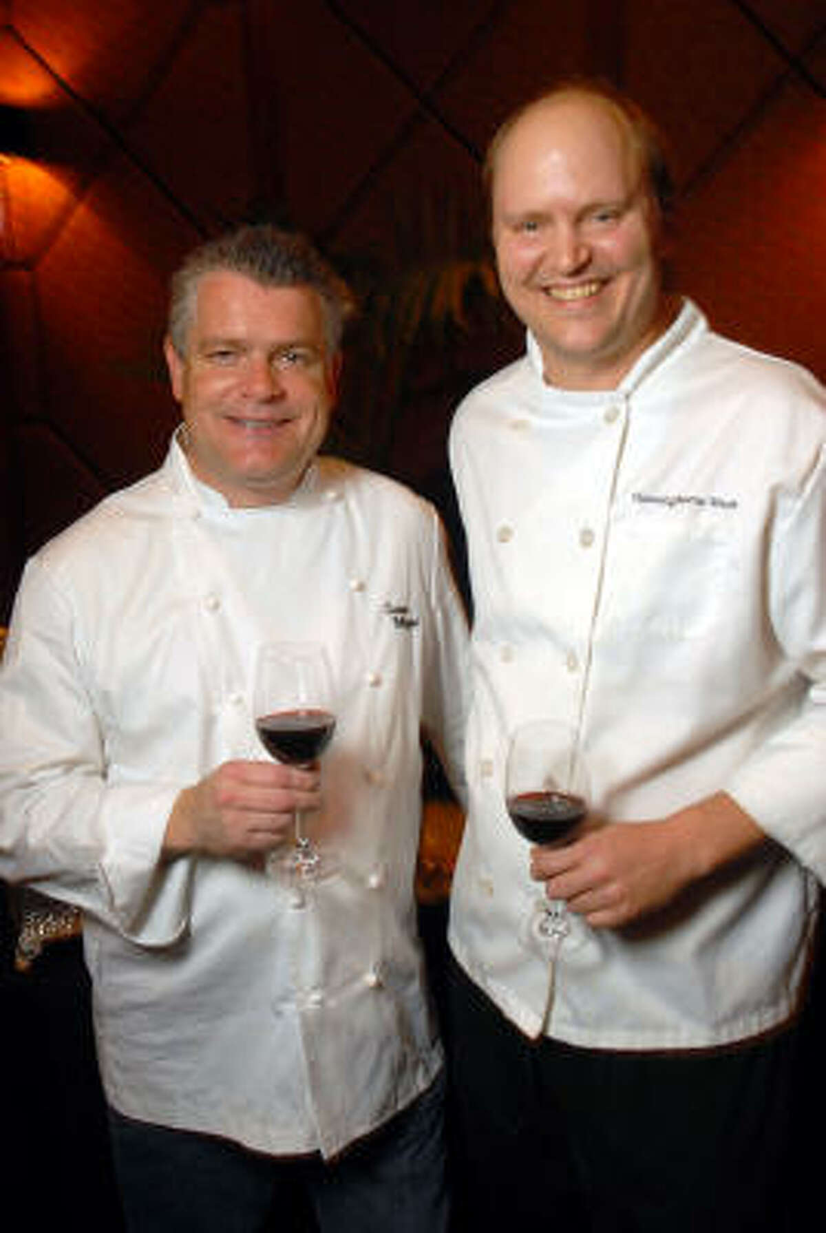 Luciano Pellegrini and Cunningham West toast the new restaurant.