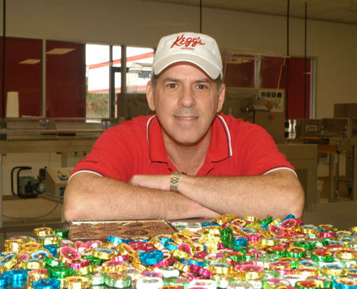 Carl Bartuch posed with candies from Kegg's Candies Factory.