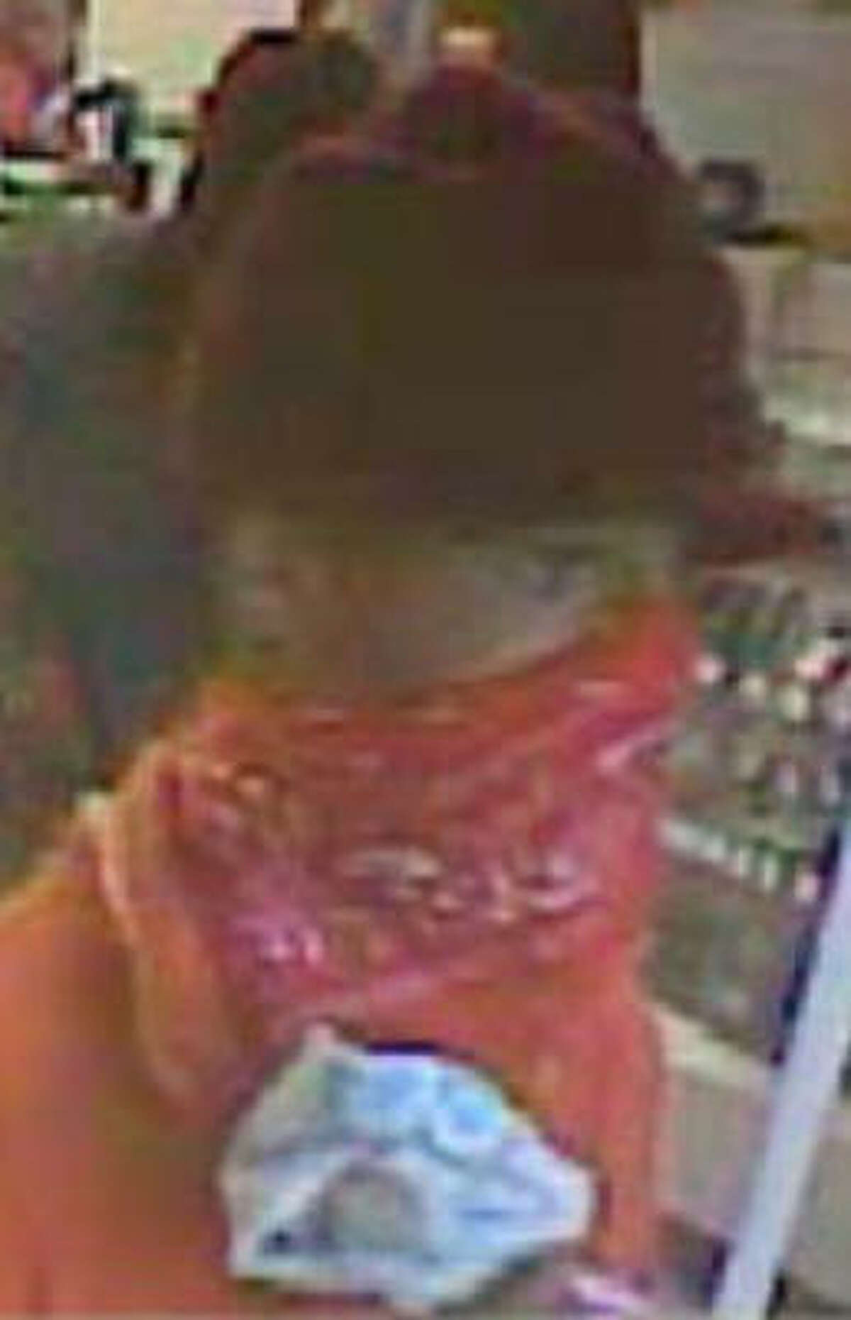 This person and two others are suspected of robbing four Houston-area pawn shops since July 31.