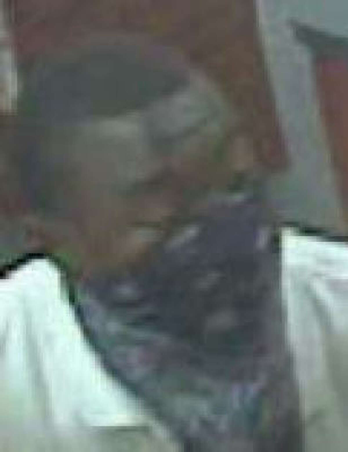 This person and two others are accused of robbing four Houston-area pawn shops since July 31.