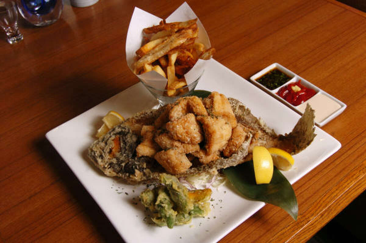 "At Kata Robata, the Flounder Fish and Chips dish is served on a whole flounder body and the ""chips"" come in a glass."