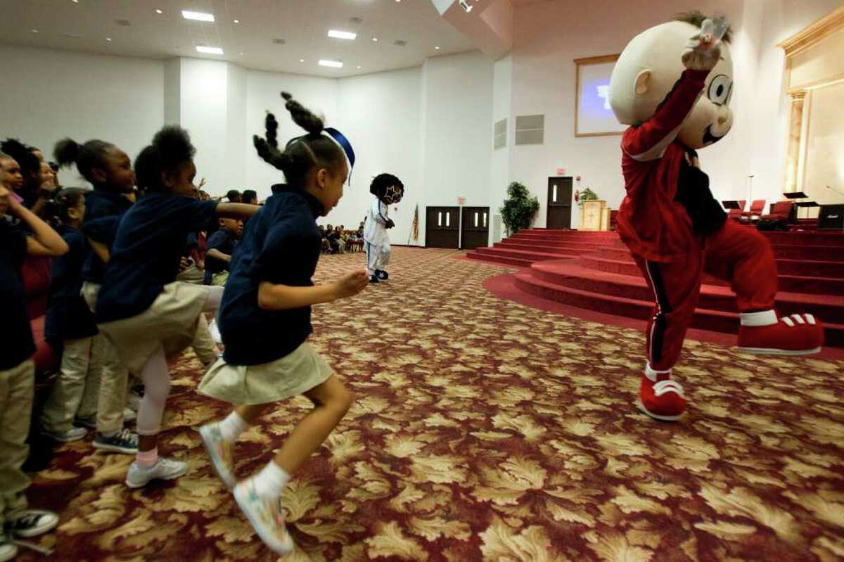 Charles Vienn II performs as Baby Isaac as students dance during an anti-bully program at the Christian Life Center Thursday, May 5, 2011, in Houston. ( Brett Coomer / Houston Chronicle )