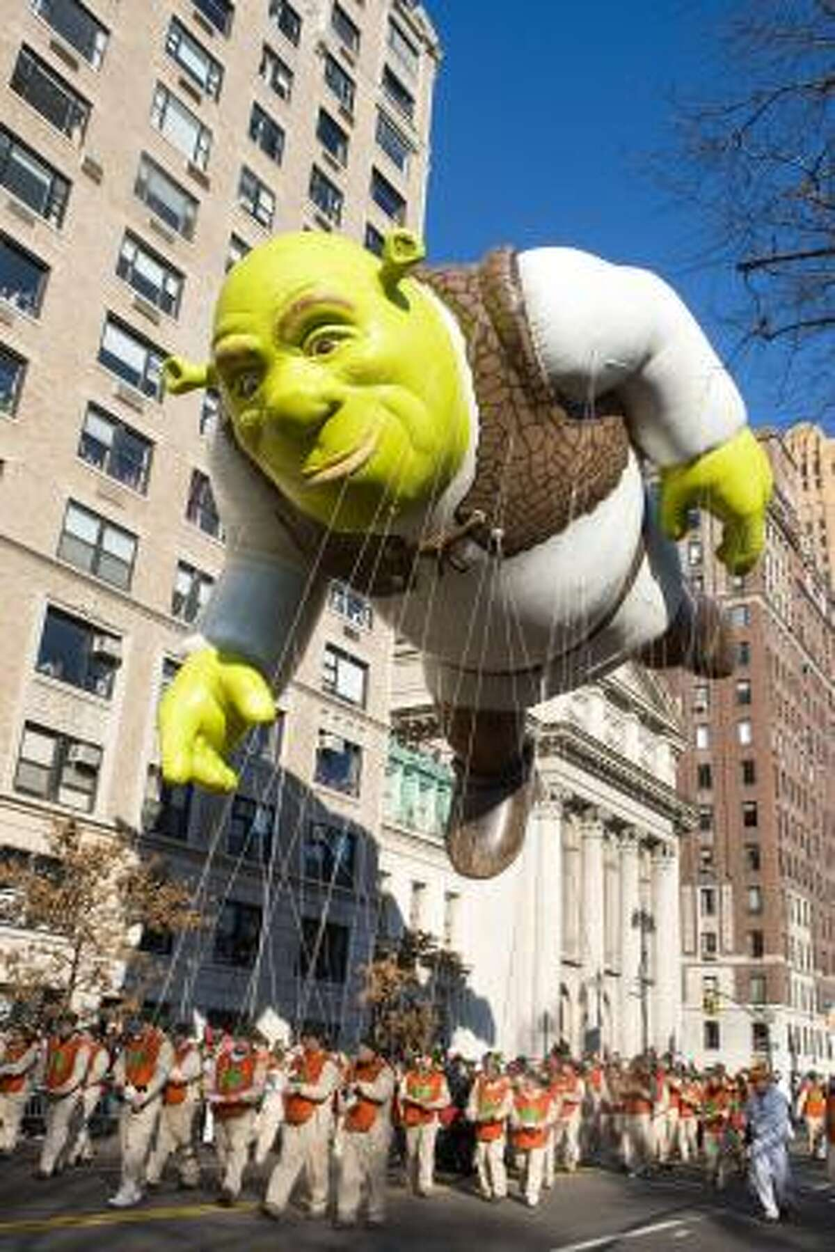 Macy's Thanksgiving Day parade is altering its route from a fairly straight shot to one with several turns. The turns will be a challenge for the handlers of the giant balloons, which measure several stories tall and are filled with thousands of cubic feet of helium.