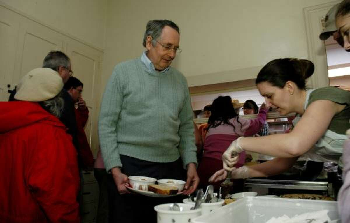 Ronald Shewchuk gets a plate for himself and his wife, Helen, at a soup kitchen in Ithaca, N.Y. They have eaten many of their meals there since losing most of their retirement savings.