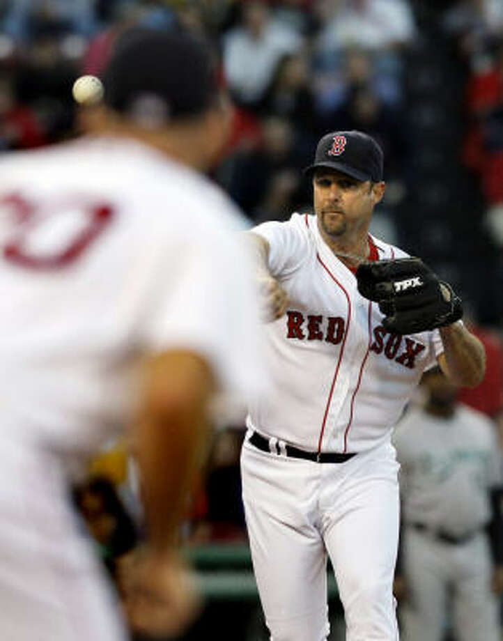 Boston's Tim Wakefield worked his way to his ninth win, holding the Marlins to two runs on six hits in six innings Tuesday. Photo: Elise Amendola, AP