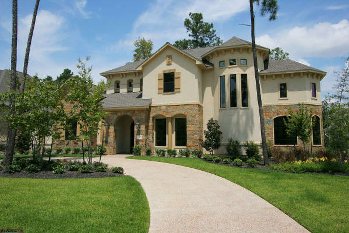 LINKING UP: Ready for move-in is the traditional-style home at 2 Harmony Links, on a corner site, in the neighborhood of Knightsgate in The Woodlands' Village of Sterling Ridge. Built by Marshall & O'Connor Building, this two-story home is priced at $982,700.