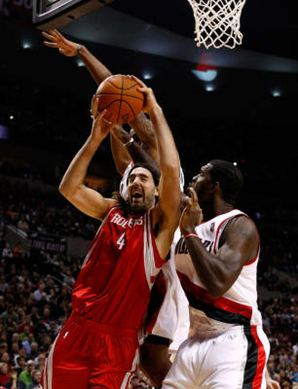 Rockets forward Luis Scola (4), shown against Portland, scored 21 points in Houston's 108-107 win over the Warriors on Wednesday night.