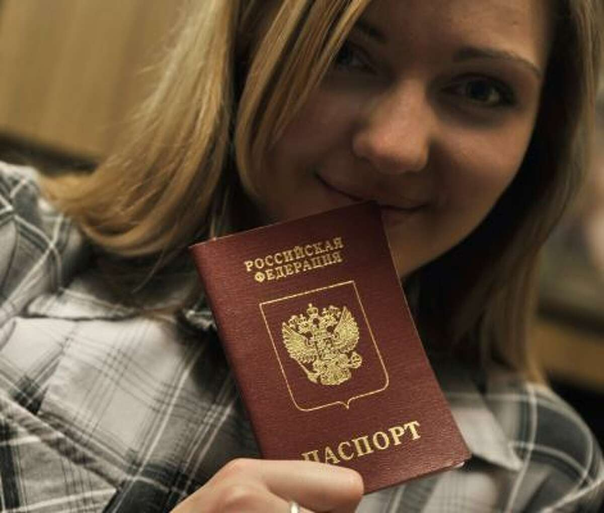 Sasha Arshinova of Transnistria, a separatist province, shows a prized possession — a Russian passport.