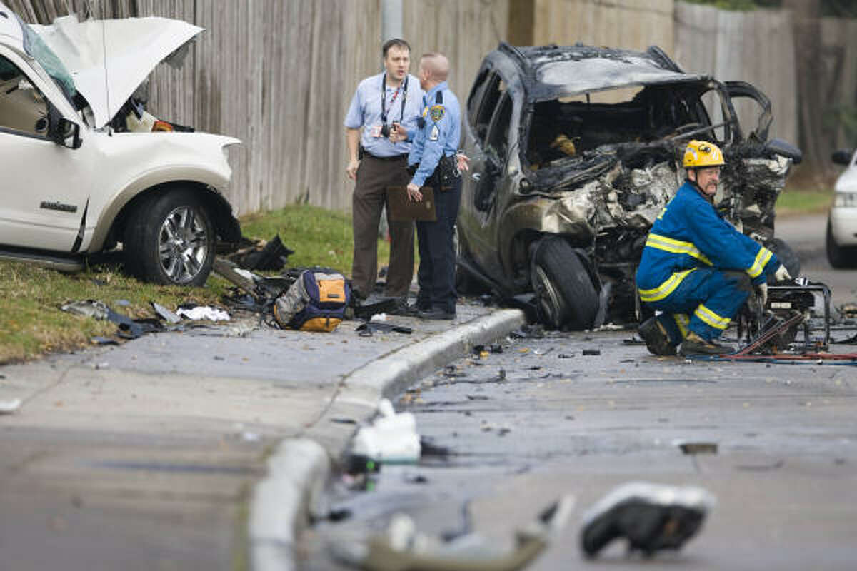 Houston police say the SUV at right ran a red light before colliding with the SUV at left and bursting into flames.
