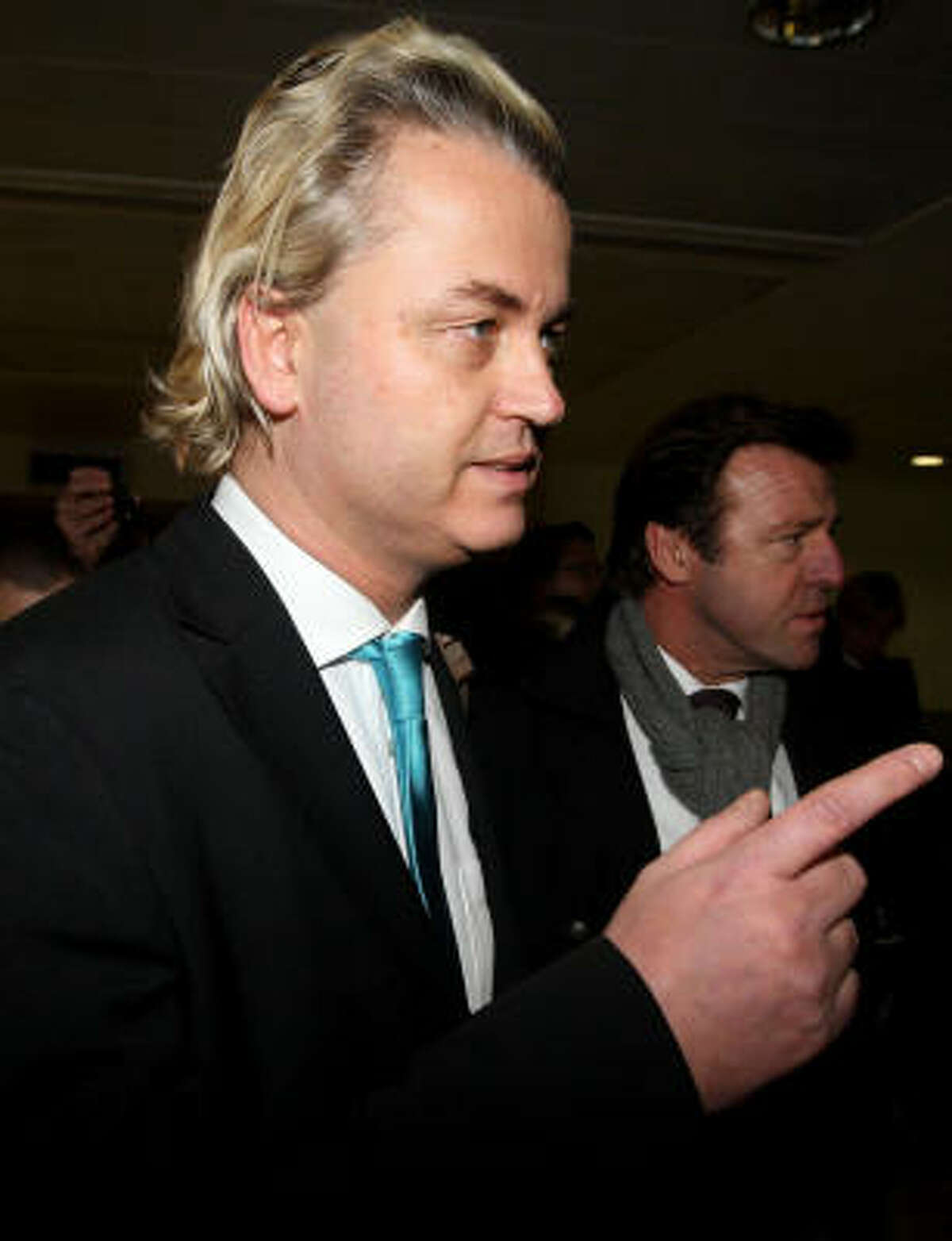 Dutch right-wing politician Geert Wilders, left, seen at Heathrow Airport, London, after being banned from entering the country, Thursday. Wilders planned to show his anti-Islam film