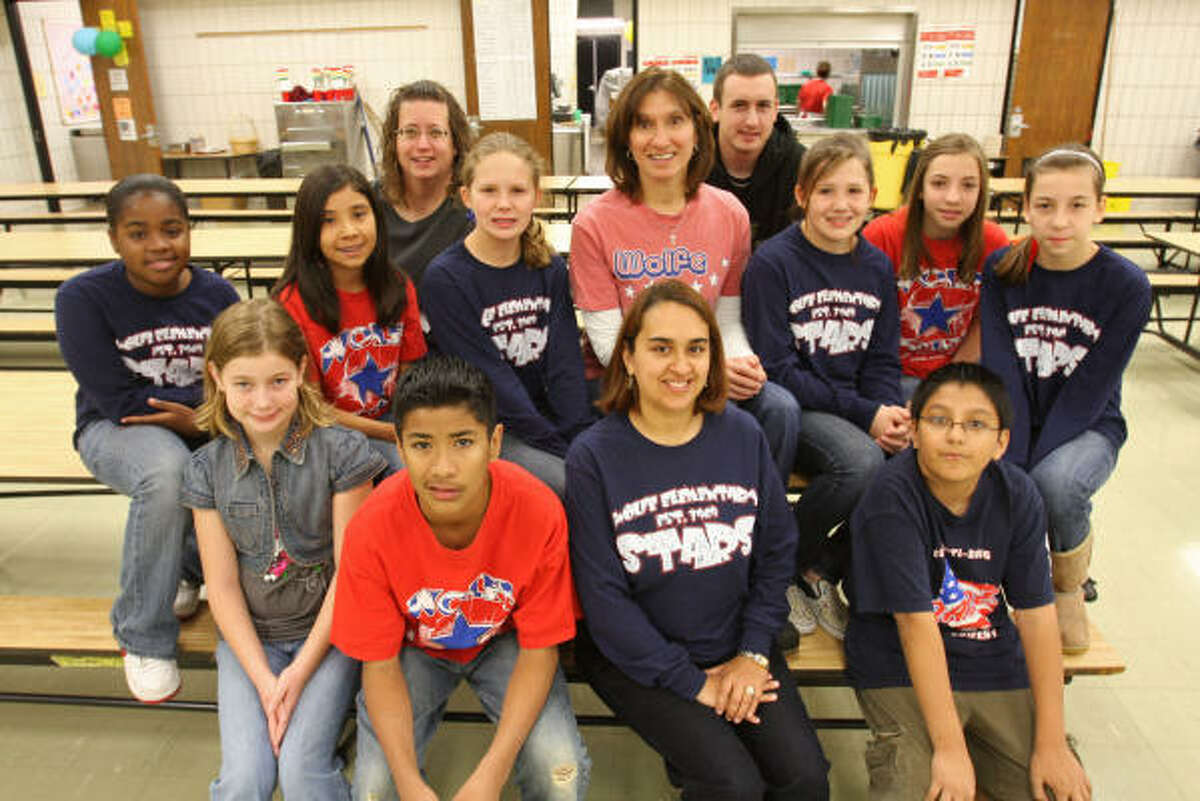 The Wolfe Elementary Relay for Life team includes, front row, from left, fifth-graders, Ciara Kavanagh, 10; Julio Lara, 12; Yolanda Ramirez, ESL teacher; and Alex Juarez, 10; second row, from left, Quincee Miles, 10; Elieanna Deleon, 11; Whitney Woolie, 11; Shari Lopez, nurse; Katie Woolie, 11; and Lauren Montshine, 10; back row, from left, Joanne Alley and her son, Matthew Alley, 21, and Sarah Montshine, 10.