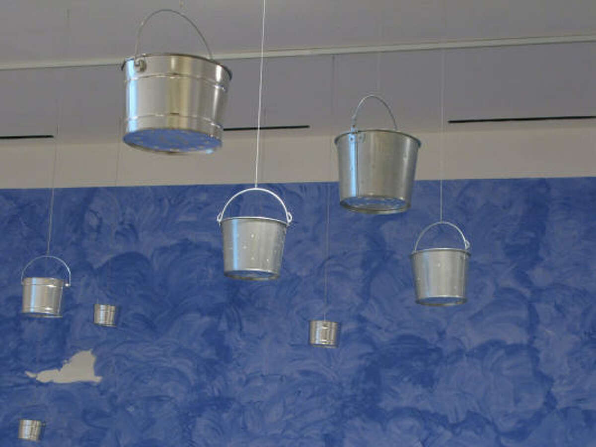Helen Lessick's Untitled [The Night Sky], 2009, features 23 altered and suspended pails.