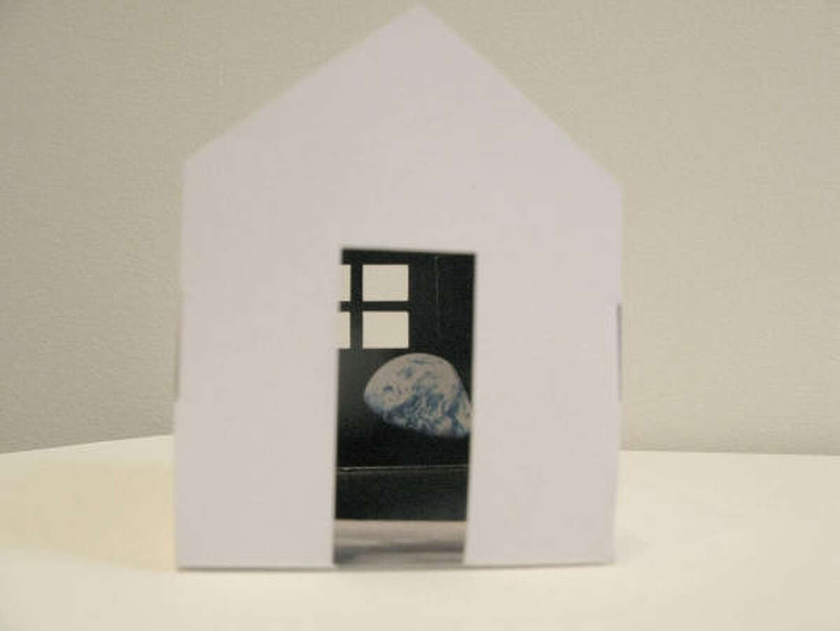 Some of Helen Lessick's house-themed works feature cutout doors and windows.