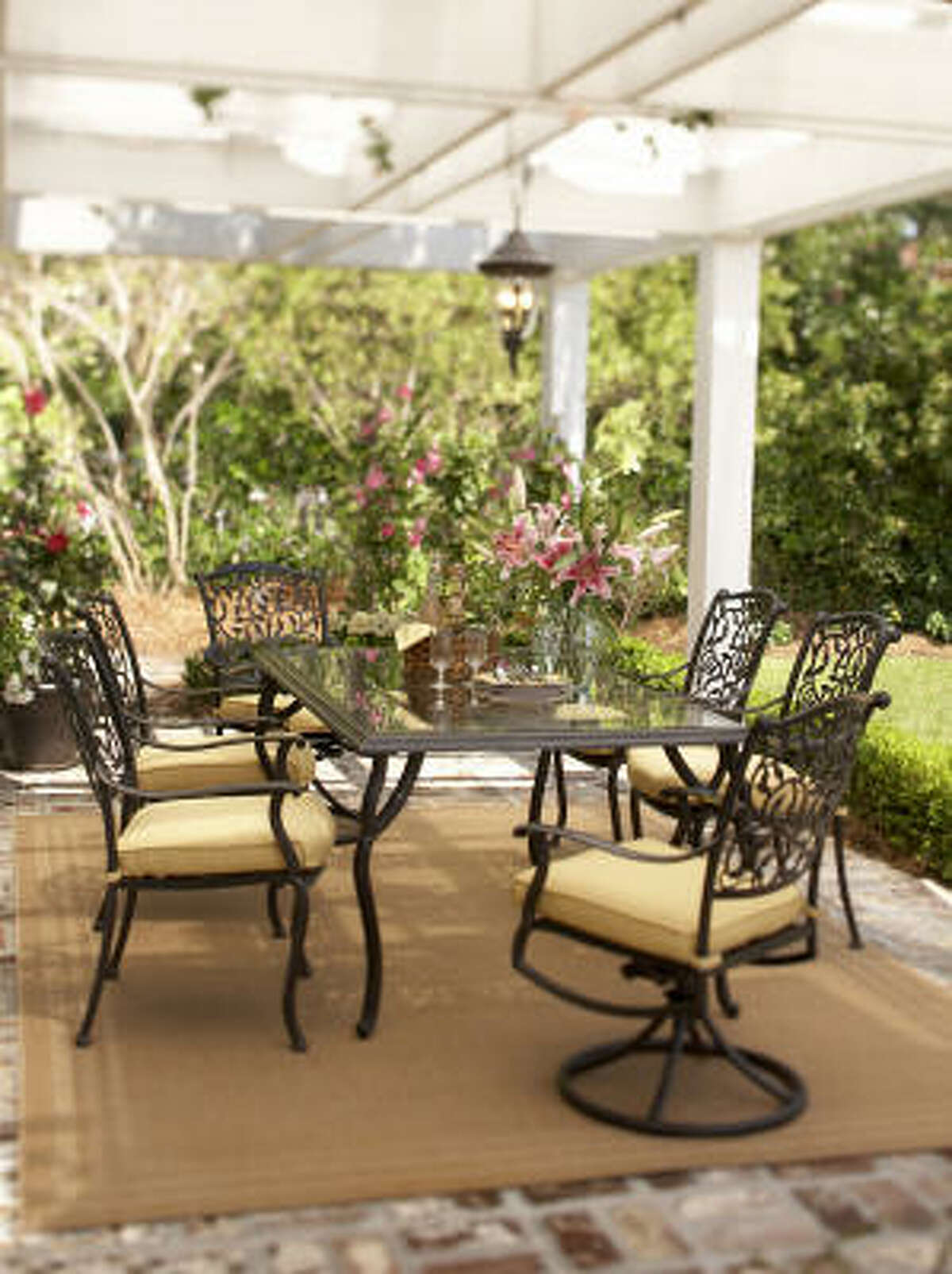 A great outdoor dining room sets the stage for summer entertaining, Megan Clark says. The Roslyn patio set can be ordered at Lowe's.