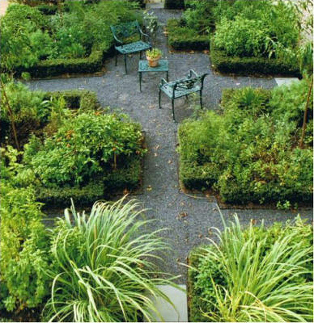 Black Star gravel paths through this herb garden mean less mowing, edging and water use. An expanded area at the path's intersection provides room for a couple of chairs that offer a resting spot while gardening