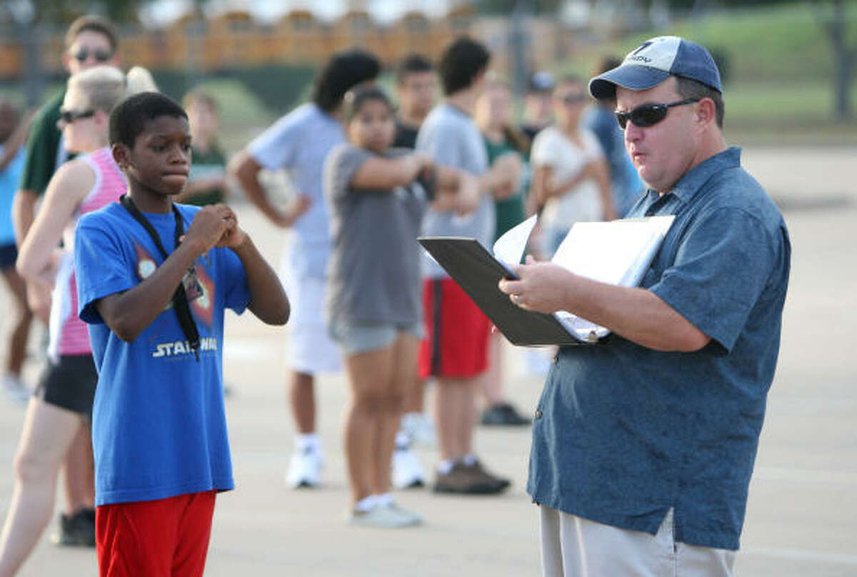 PRACTICE MAKES PERFECT: Band director James Dolnik goes over marching formations during the Mayde Creek High School Mighty Ram Band practice for their Aug. 29 performance during the football game between Mayde Creek and Brenham at the Alamodome in San Antonio.