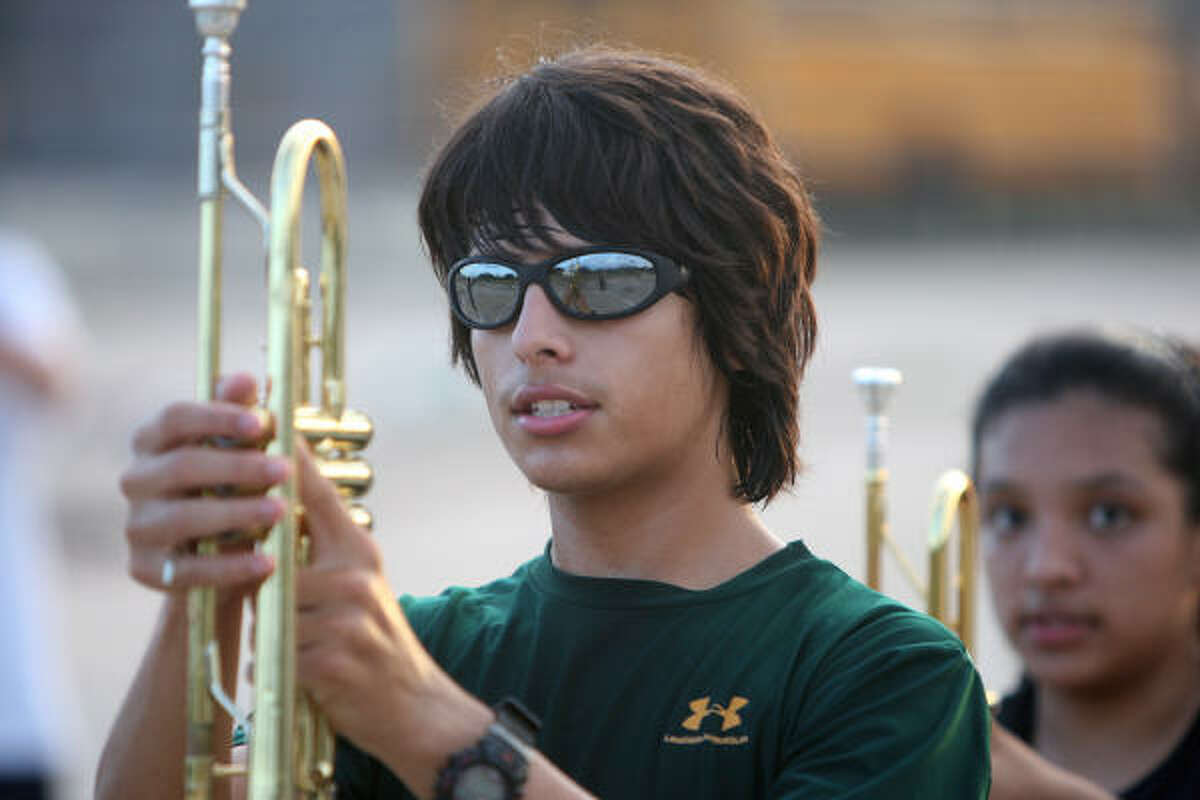 Mario Zuniga, freshman, practices with the Mayde Creek High School Mighty Ram Band.