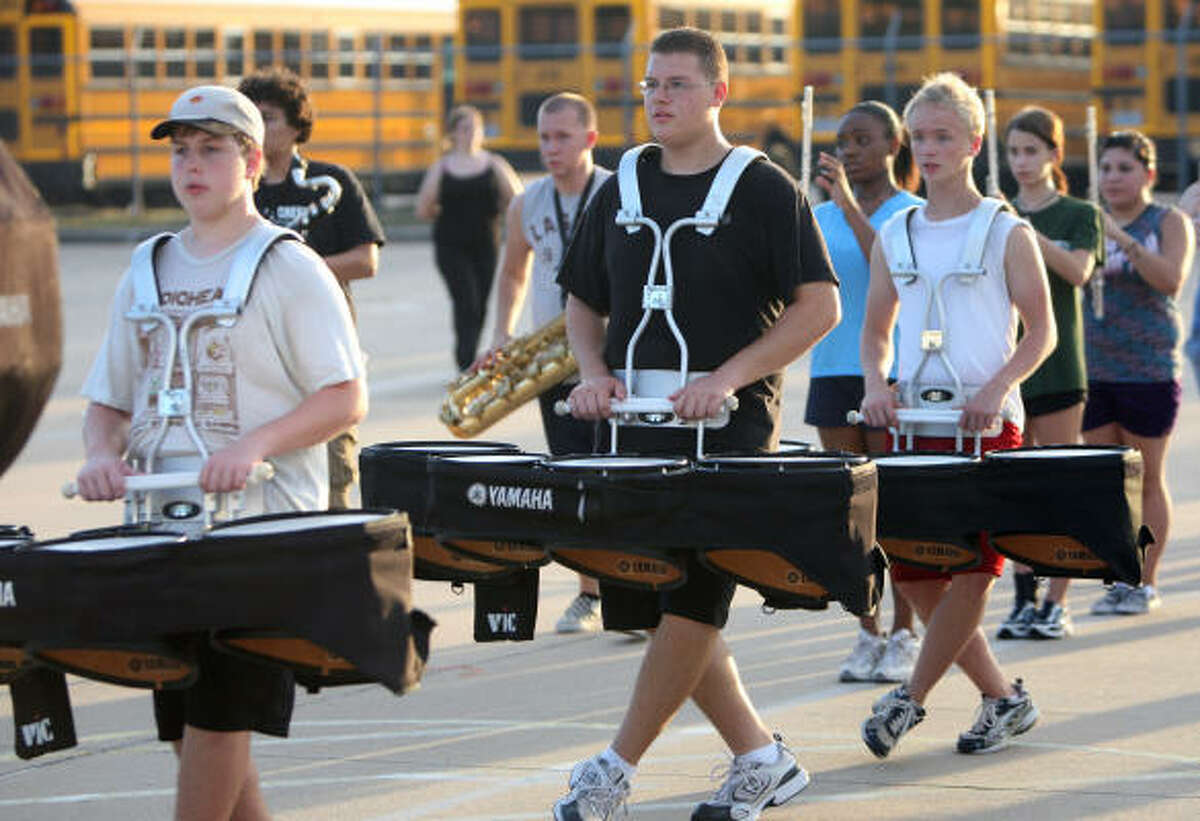 Ethan Sedelmeier, freshman, left, Caleb Bryant, senior, and Caleb Foster, junior, play the drums.