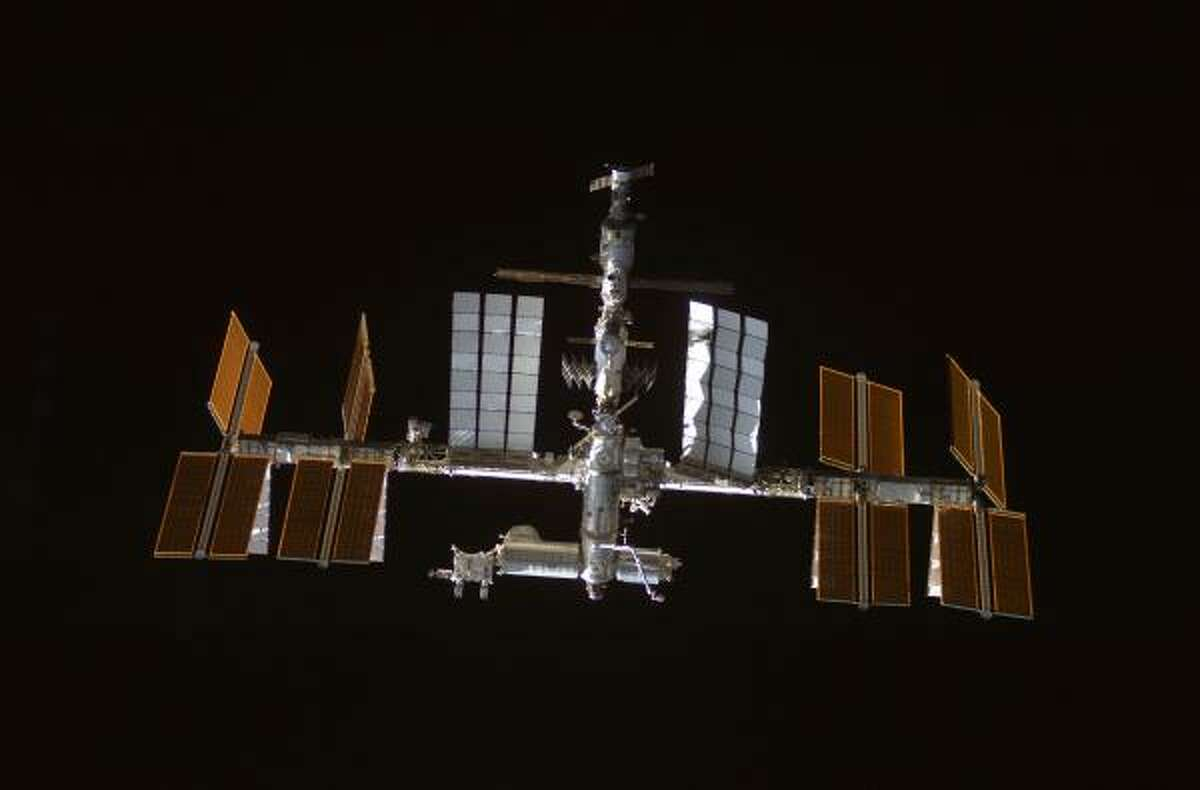 This image provided by NASA shows the international space station backdropped by the blackness of space.