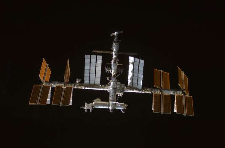 This image provided by NASA shows the international space station backdropped by the blackness of space. Photo: AP