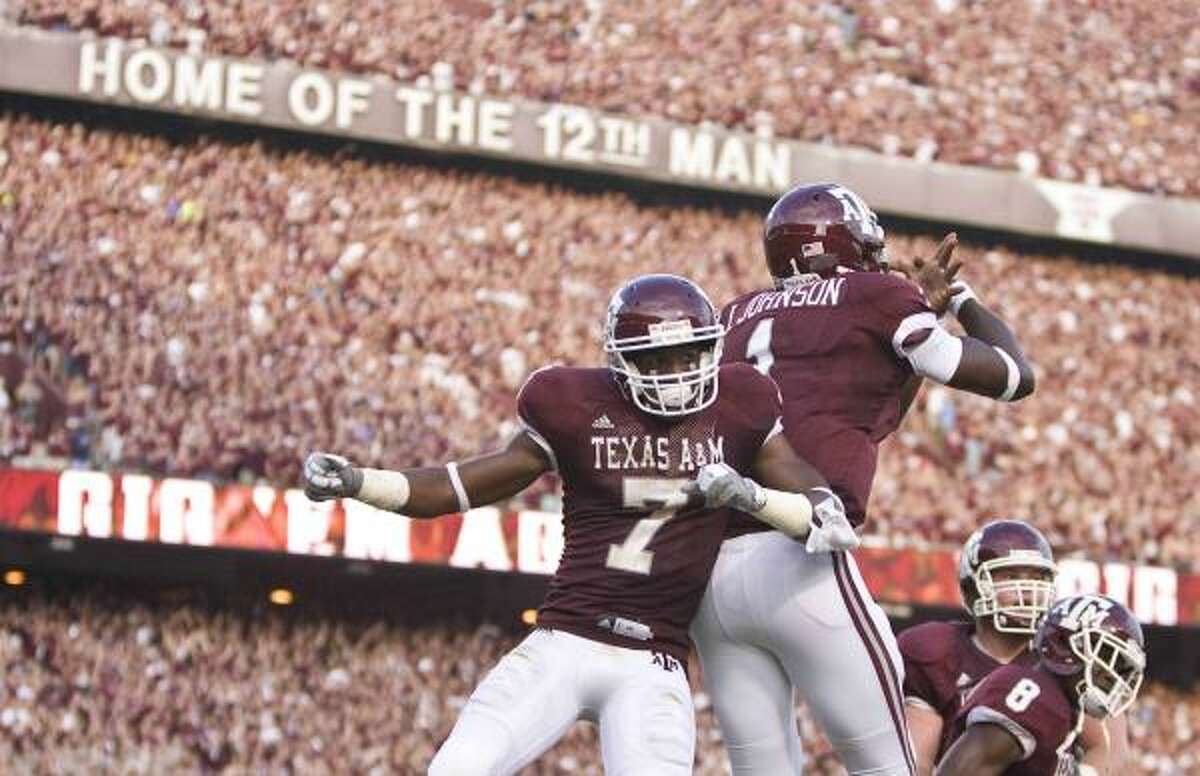 A&M receiver Uzoma Nwachukwu, left, and Jerrod Johnson celebrate after hooking up on a first-quarter touchdown.