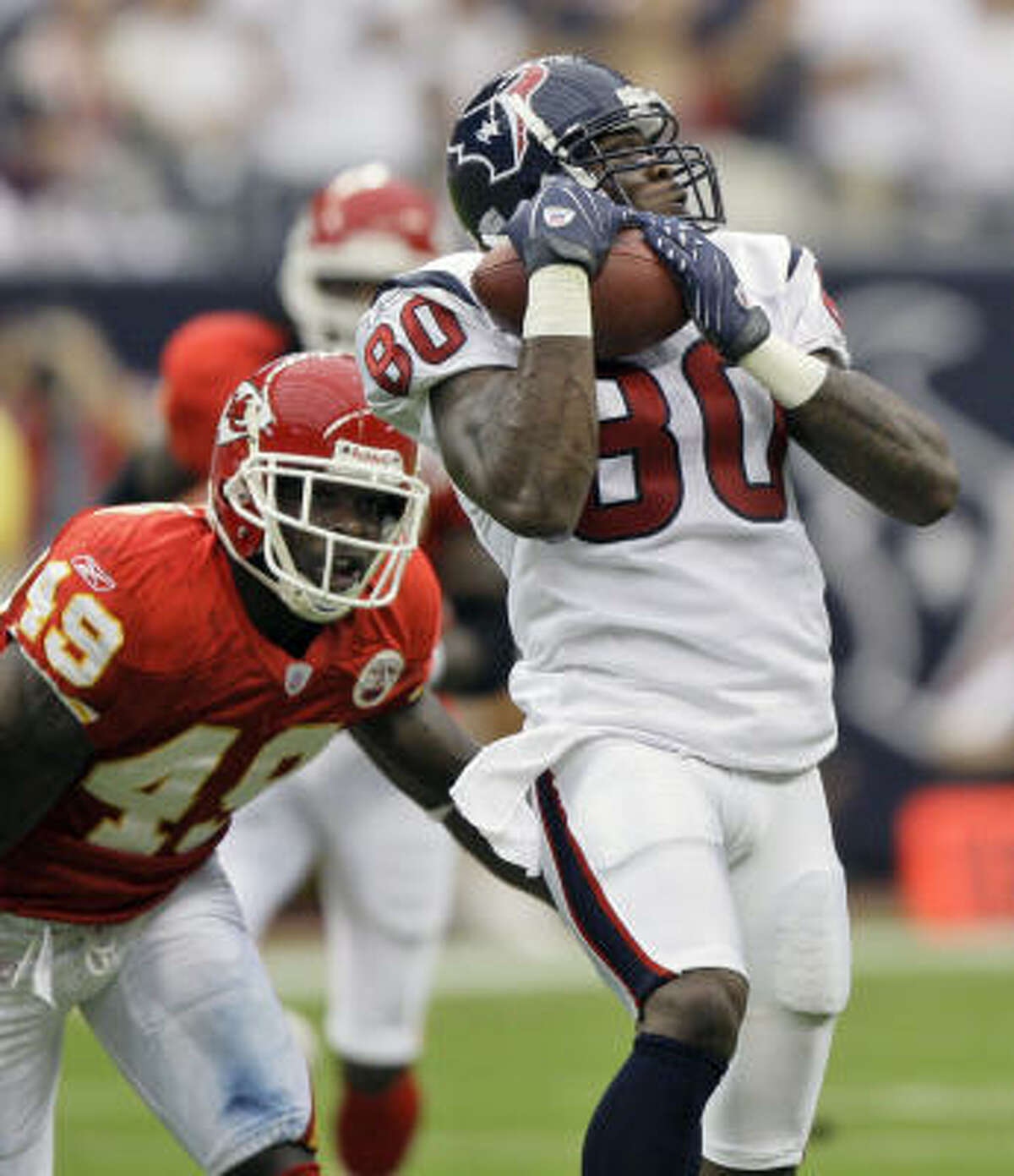 In 2007, Bernard Pollard (49) was a safety with the Chiefs trying to make a play on future teammate Andre Johnson.