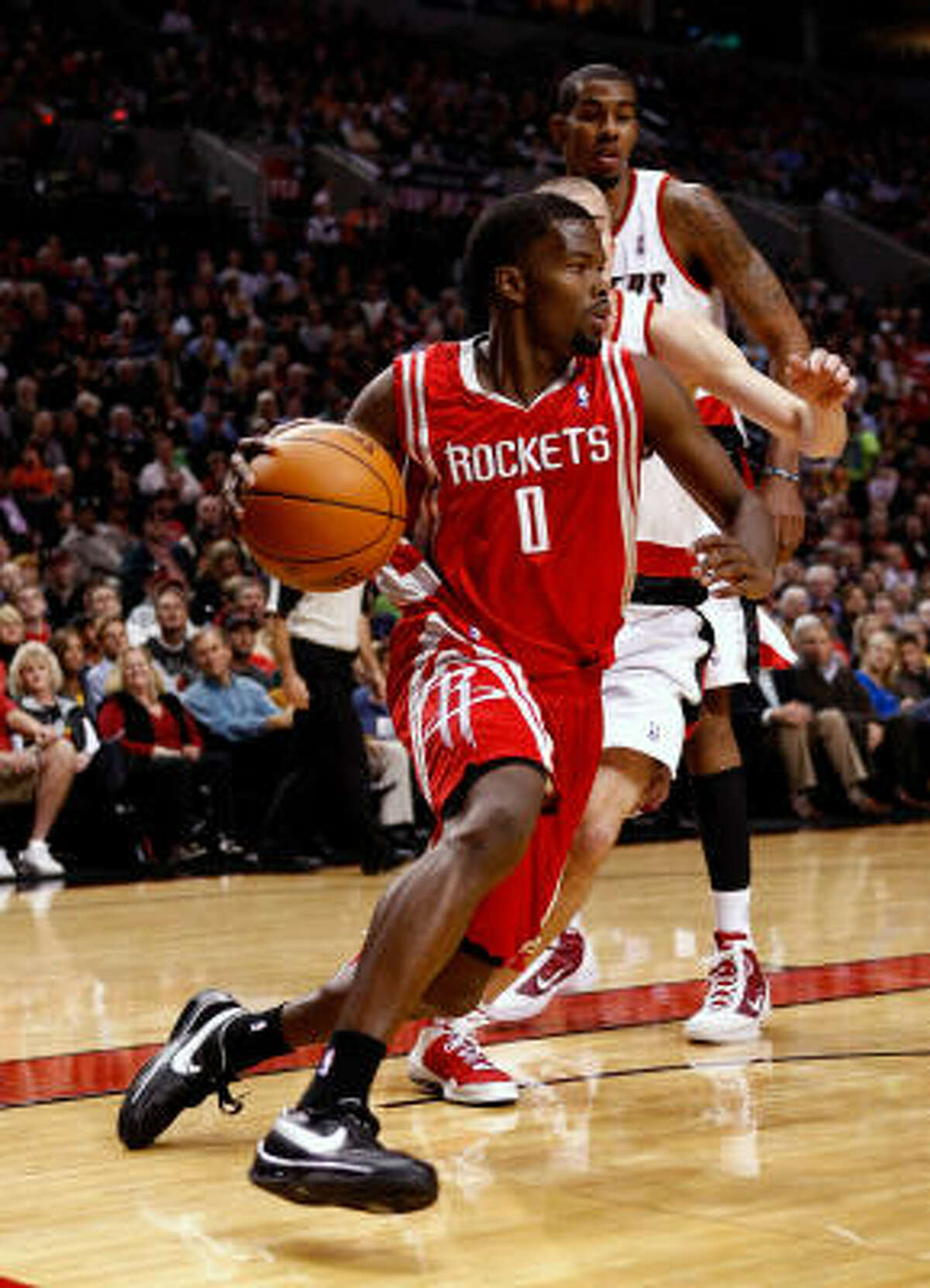Aaron Brooks (above) led the Rockets with 19 points, playing much of the fourth quarter with Kyle Lowry, who provided a much-needed lift.