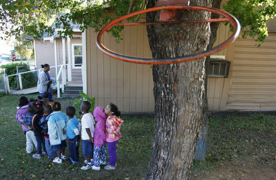 The pre-school class at Walker's Day Care will soon have lots of things to play with on their playground. Photo: Mayra Beltran, Chronicle