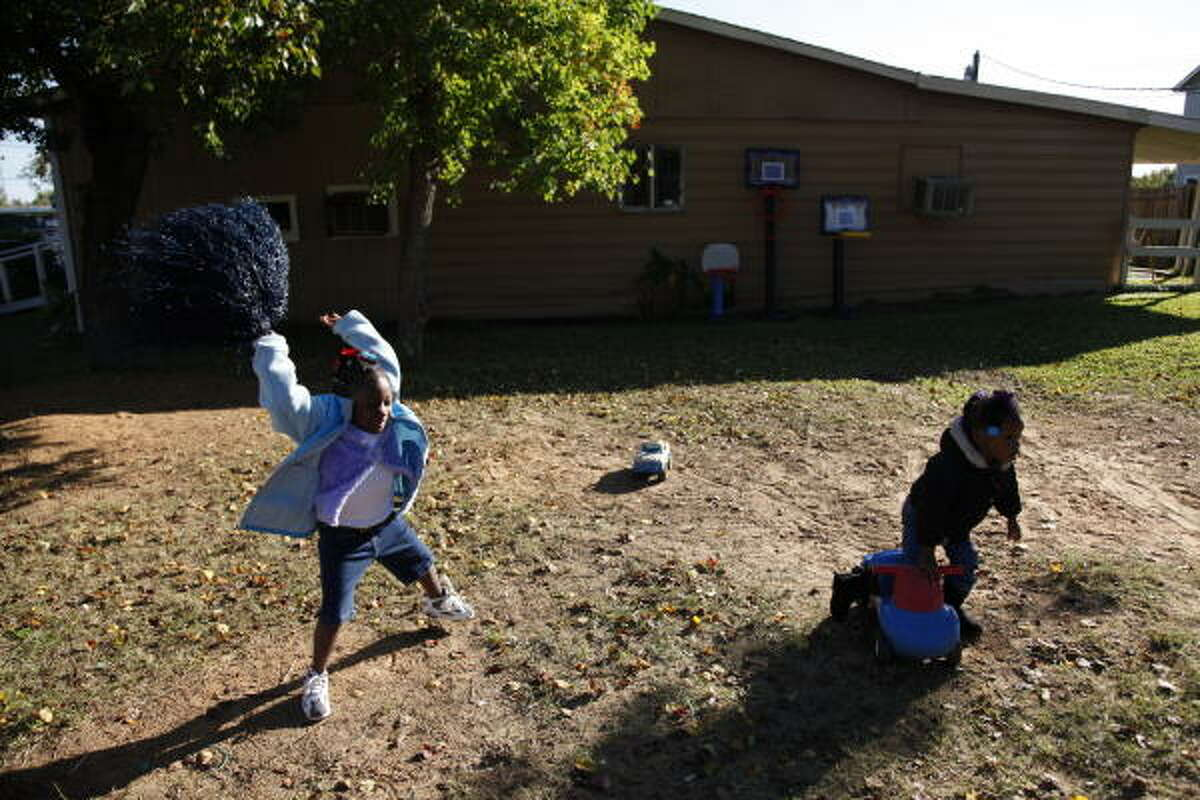 If Whitney Ray, 4, left, and Damijahia Paul, 3, can have this much fun with almost no toys, imagine how excited they'll be after Santa Yao's elves rebuild their playground.