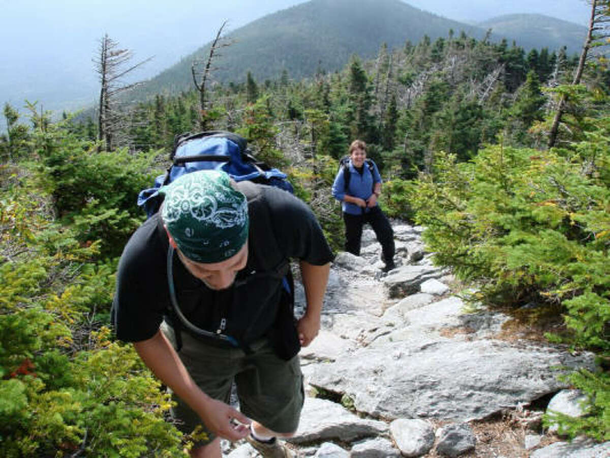 Hikers Alan Perry and Laura Hardy climb the Monroe Skyline, a section of the Long Trail near Mount Abraham.