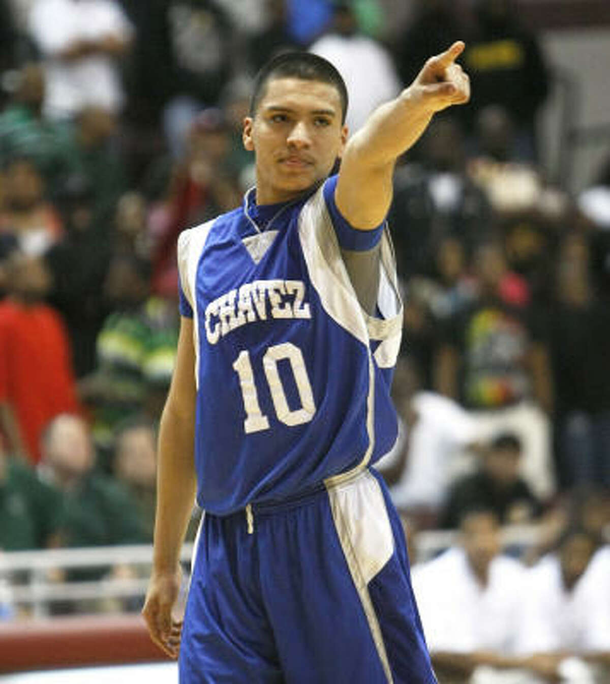 Chavez's Robert Martinez points to the crowd after making some big free throws in the last minutes of Chavez's 54-53 upset win over Hightower.
