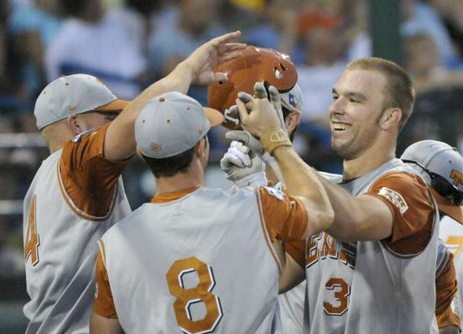 Texas' Cameron Rupp, right, may not seem like he takes himself seriously, but his performance during the CWS shows why he has the attention of major league scouts. Photo: Ted Kirk, AP