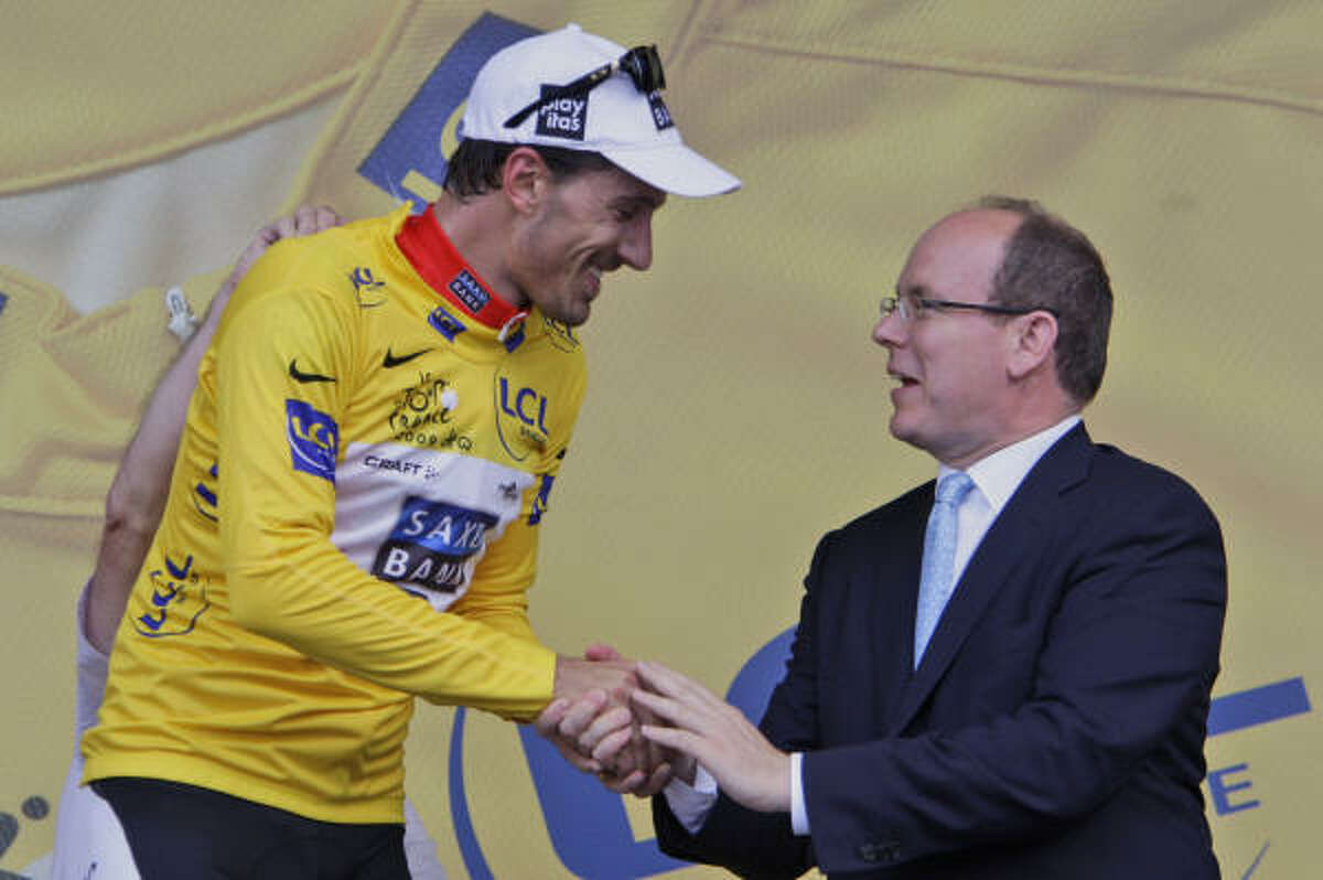 Prince Albert II of Monaco, right, congratulates overall leader Fabian Cancellara of Switzerland after he won the first stage of the Tour de France on Saturday.