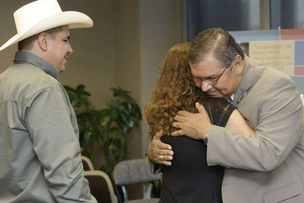 """Laurie Trevino and Mario Gallegos embrace after the senator met with Robby Trevino Sr. and his wife. """"Because of this young man, I am here,"""" Gallegos said of Robby Jr., whose unexpected death led to a liver transplant for the senator."""