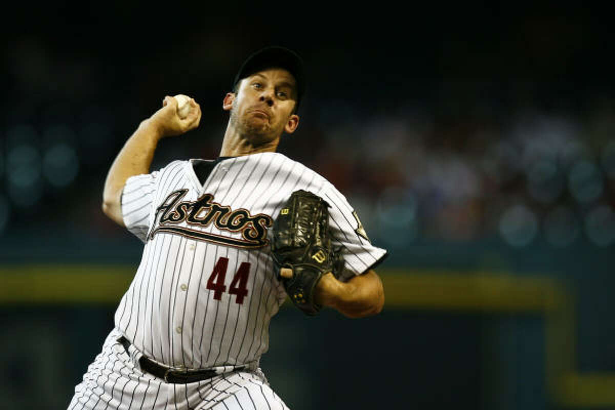 Roy Oswalt allowed three runs in seven innings of a pitcher's duel against Chris Carpenter.