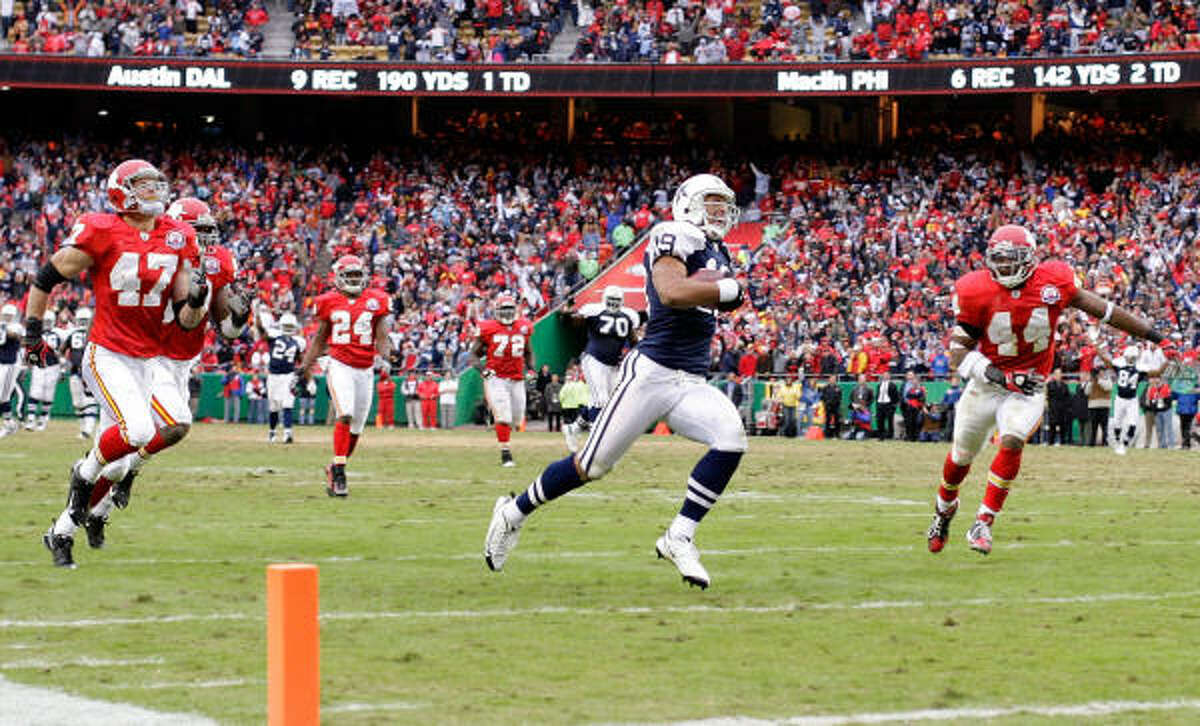 Miles Austin had 10 catches for 250 yards, including a 60-yard score in overtime.