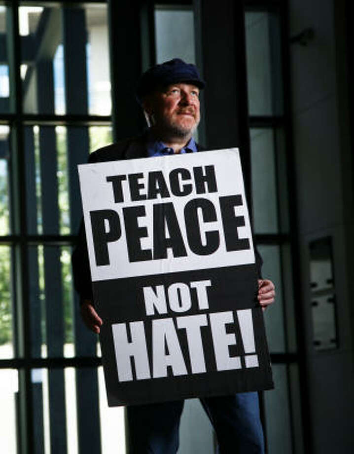 Ira Bleiweiss is trying to teach others about tolerance by taking out billboards around town urging the message of peace.  Bleiweiss also helps spread his message by volunteering as a docent at the Holocaust Museum. Photo: Michael Paulsen, Chronicle