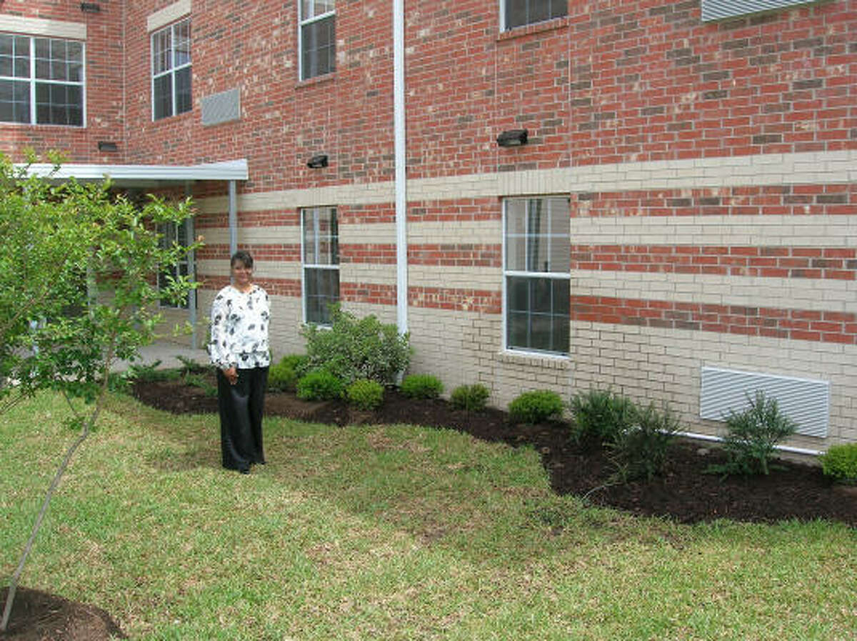 Manager Gaynell McKee in front of the new-and-opening soon Bayou Glen Housing (an affordable senior housing community) at 11810 Southglen in the Alief area.